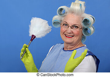 Elderly lady dusting