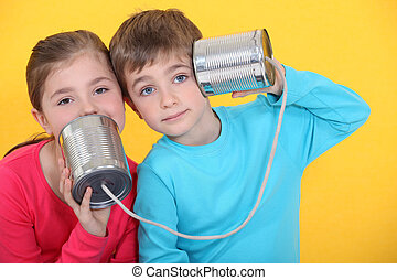 Children playing with tin cans