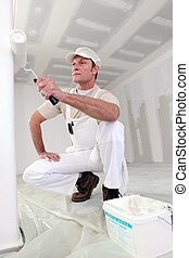 Male decorator with roller