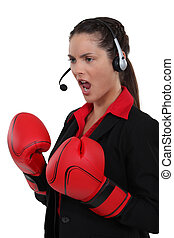 call center employee wearing boxing gloves