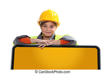Little girl in construction uniform