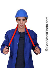 Worker carrying a pair of pliers behind his neck