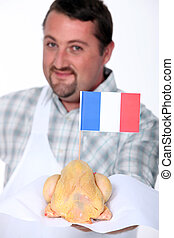 Man with French poultry