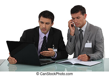 Two lawyers discussing case notes