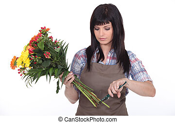 Florist cutting stems off flowers