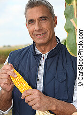 Farmer holding corn