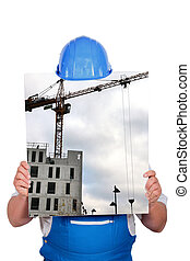 blue collar hiding behind picture of construction site with...