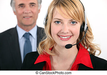 Smart woman wearing a telephone headset