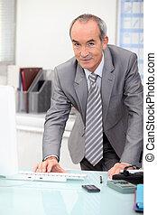 Elderly man in office