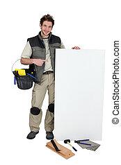 Tiler pointing at blank advertising panel
