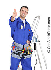 Handyman stood by equipment giving the thumbs-up