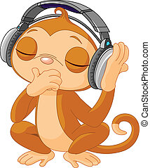 Cute little Monkey listening music with headphones