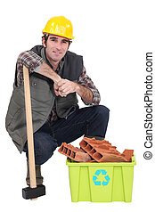 Worker with box full of debris