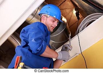 Men examining ventilation system