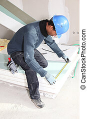 Man measuring insulation boards