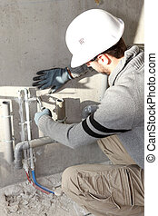 Plumbers installing drainage