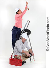 man and woman electricians