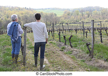 Winegrowers in front of vineyards