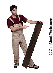 Man pointing a plank of flooring