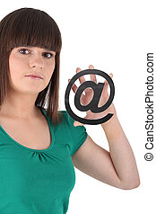Teenager holding at sign on white background