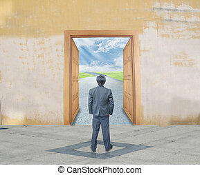 Businessman with success door