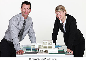 Two architects working together on project