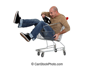 Man racing a shopping trolley