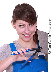 handywoman using pliers on a tile
