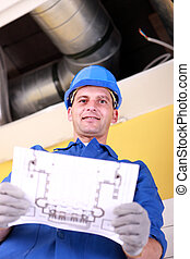 Plumber with the schematics of an air conditioning system