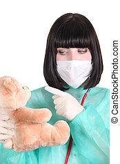 Doctor scolding a teddy bear