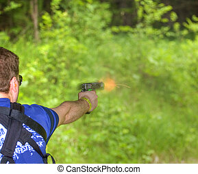 Muzzle flash - Fire and smoke coming from the end of a...