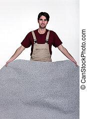 Man laying new carpet