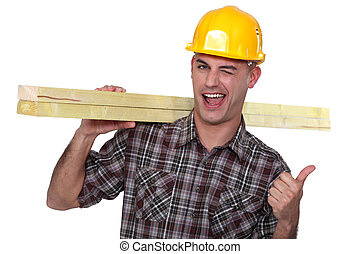 Cheeky carpenter giving the thumbs-up