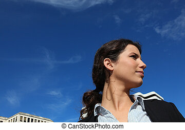 Young businesswoman against a blue sky