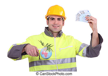 Builder with a globe and cash