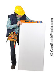 Handyman checking the level of a board left blank for your message