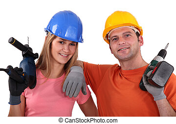 Man and woman with drill