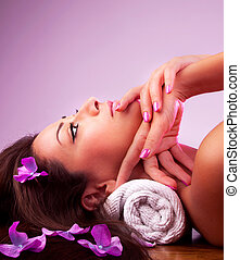 Beautiful relaxing female in spa salon