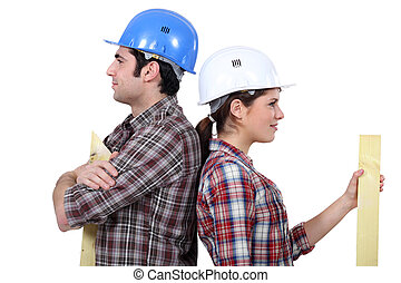 Male and female builders back to back