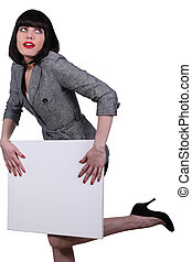 Brunette businesswoman holding messageboard