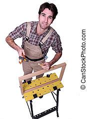a carpenter making a wooden frame
