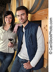 Couple standing in a wine cellar