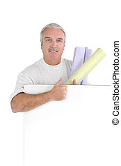 Man holding rolls of newspaper