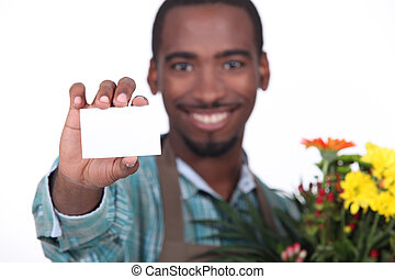 African florist with business card
