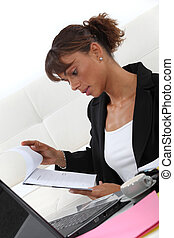 Businesswoman looking at a notepad