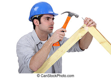 woodworker working with a hammer