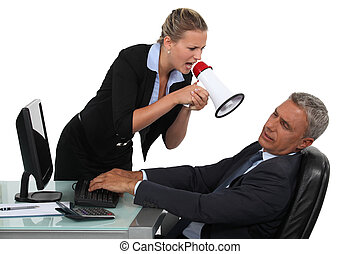 Woman with megaphone yelling at man in the office