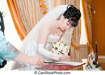 Pretty bride signing document