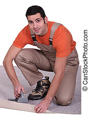Man placing carpet