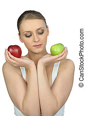 Woman holding a green and red apple